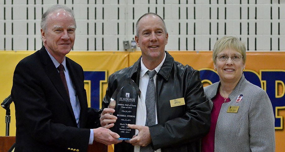 Sterns (center) was officially inducted into the St. Edward's Athletics Hall of Fame by President George E. Martin (left) and Athletic Director Debbie Taylor (right) on Feb. 28.