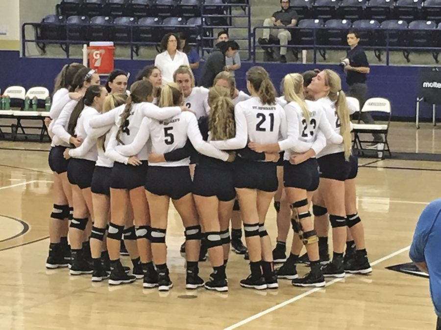 SEU+volleyball+huddles+after+winning+their+conference+opener.